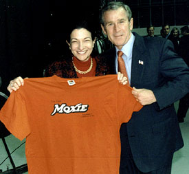 US Senator Olympia Snowe and former President George W. Bush pose with a MOXIE t-shirt.